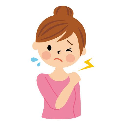 慢性の肩こりで苦しむ若い女性